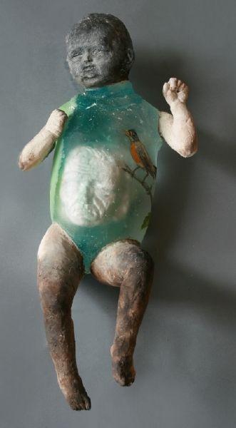 Christina Bothwell , Kundalini   -  Cast glass, window glass, raku clay, found objects, oil paint, made in:  2011