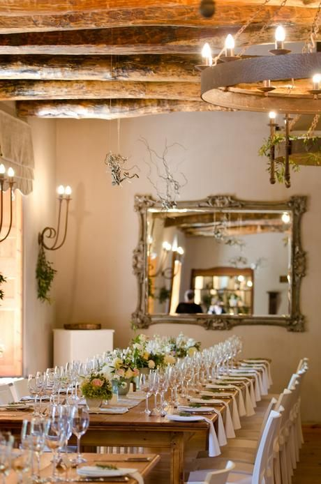 Rustic cream, blush and peach wedding. Olive and herb greenery with rose, stocks, dahlias and spray roses in loose, organic arrangements using duck egg urns and vintage bottles for centrepieces. Flowers by www.botanica-flowers.co.za