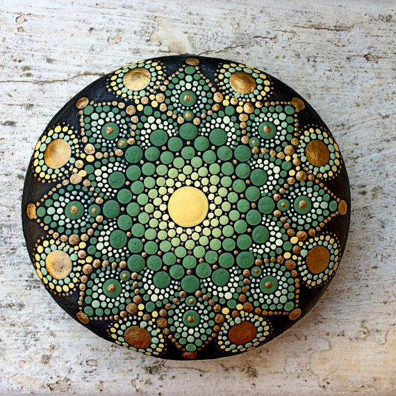This dotted Mandala sea stone I carefully painted with precision and joy in acrylic paint and finished with matte varnish. It is approximately 7.5 cm diameter, and is suitable for indoors decoration. Please handle with care and do not put in water or direct sunlight.  The back of the stones is painted black (look for my signature there). Thank you for your purchase.