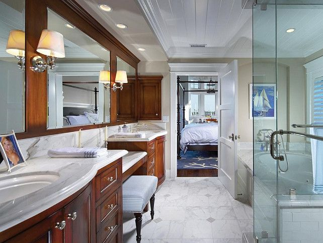 Coastal bathroom design doesn't have to mean all pale colors - the wood tones are a nice touch.