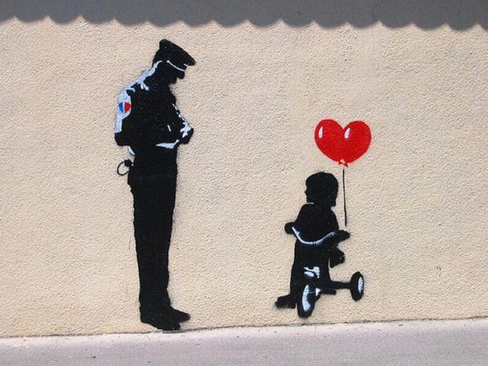 bansky bicycle | banksy-Policeman & girl on bike