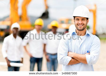 Male architect at a construction site looking happy  - stock photo