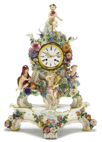 A Meissen porcelain figural and floral encrusted mantel clock on stand, late 19th century.