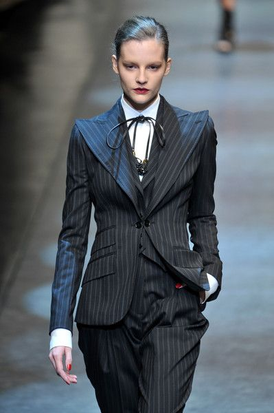 Dolce & Gabbana overall look; oversized collar; ribbon as tie; puffy pants