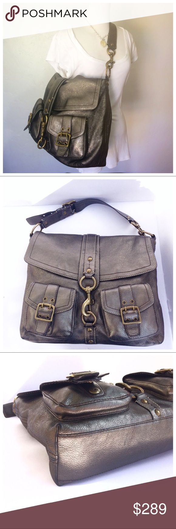"""Rare Coach Legacy Brooklyn Xl Messenger Bag Rare and stunning Coach Legacy Brooklyn Xl Messenger Shoulder Bag pewter/antique brass, Pebbled leather. Coach G06K 7466 Retail $798 Measures approx. 16"""" L x 15"""" H x 4"""" W  Adjustable strap drop 6.5"""" - 9""""   Brown signature lining. This substantial statement piece is perfect for every day, work, school or an overnight bag. It is very roomy and stylish.  Gently used in very good condition. Has a couple small marks/scuffs on front and back and bottom…"""
