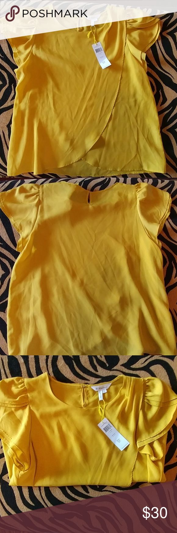 BCBGeneration Sunrise Ruffle Sleeve Top Brand new yellow flutter sleeve top with cute plea at the shoulder. 100% polyestee BCBGeneration Tops Blouses