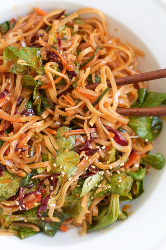 Spicy Korean Noodle Salad! Light, fresh and filled with veggies and mache rosettes! Make it spicy or non-spicy! This is the perfect summer…