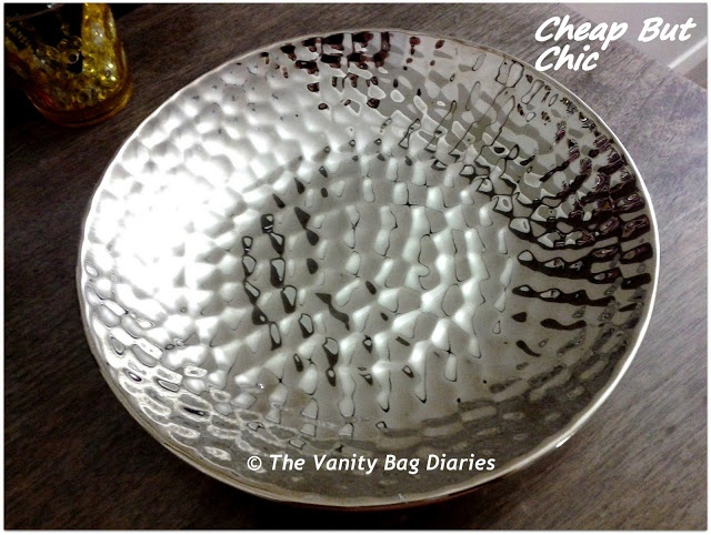 Don't we all love bargains, that too if we find something oh so luxe looking at a cool price ? This edition of 'Cheap but Chic Diaries' bring to you something on the Decor front, hope you like it.     Today's Cheap but Chic Diaries features a  decorative 'Silver dish' from Kmart. I have kept this on m