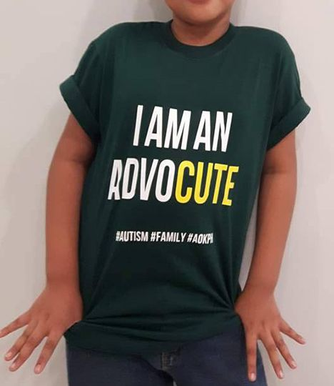 """These cotton crewneck shirts bear celebrate the unity of families who live and love with autism.  """"I am an AdvoCUTE"""". Many autism advocates just can't help being compasionate and good-looking. Ganun talaga eh."""