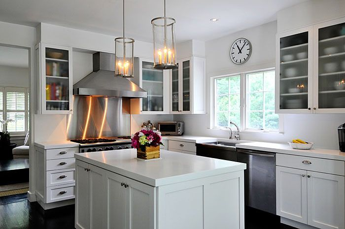White kitchen with white countertop, stainless backsplash would be cool