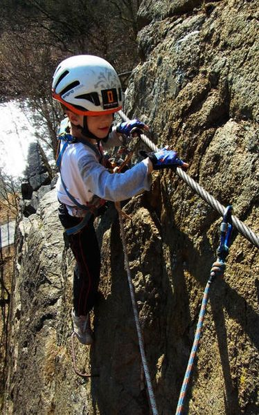 Climbing via ferrata - Secured all the time while climbing.