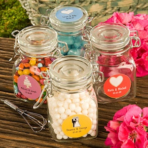Candy jar wedding favors to fill at the candy bar.. Maybe use little baggies decorated for the wedding instead of jars to make cheap wedding favors!