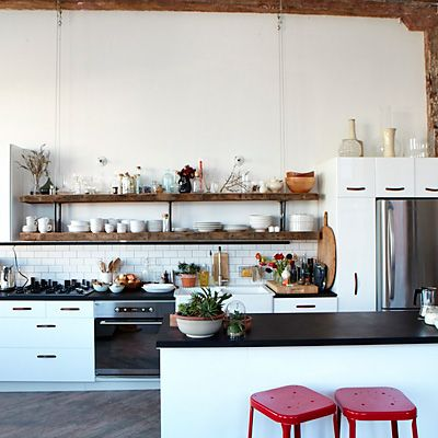 love this NY loft kitchen: open shelving, subway tiles, red stools