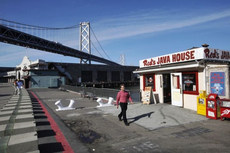 Have a bucket of beer and burger at Red's Java House on Pier 30.