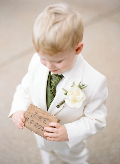 So stinkin' cute! http://www.stylemepretty.com/missouri-weddings/st-louis/2015/04/01/elegant-tuscany-inspired-wedding/ | Photography: Shelly Goodman - http://www.shellygoodmanphotography.com/