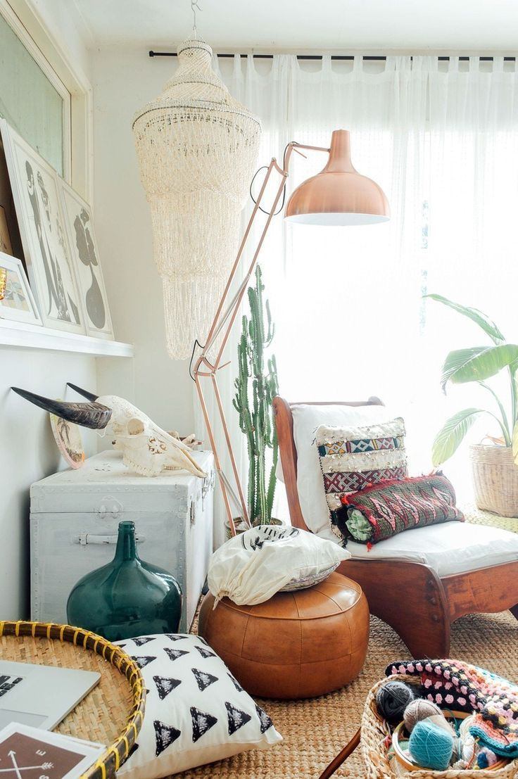 An eclectic, Nordic-inspired room. We love the copper floor lamp.