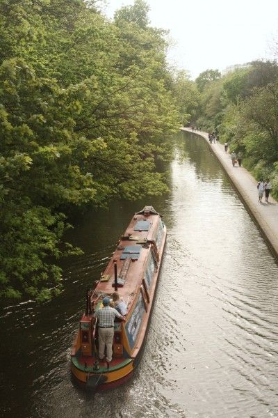 Narrow boat on the canal in Regent's Park, London