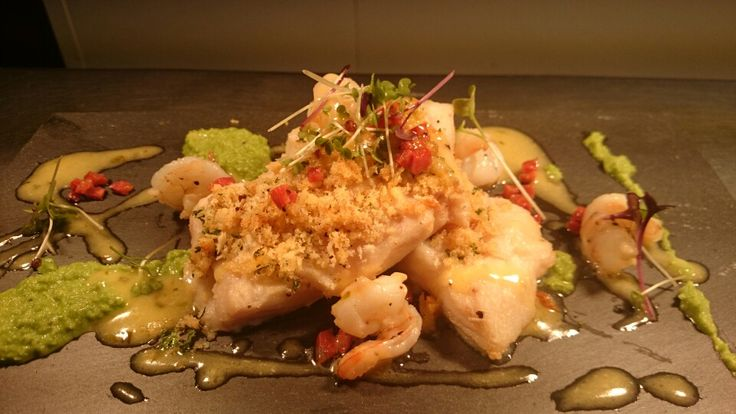 Baked hake, herb crust, pea puree, chorizo and lemon butter sauce.
