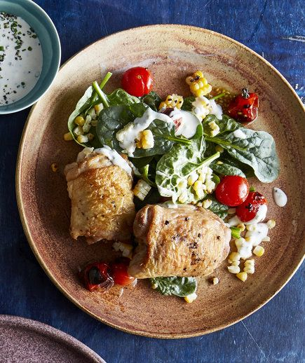 Broiling the corn and tomatoes adds a char that not only looks professional, but also adds a smoky depth to the dish. Fresh spinach adds volume and staying power to the salad, and adds a pretty hue.