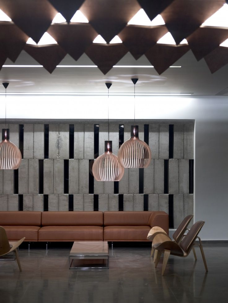 A group of black Octo 4240 pendants by Secto Design welcoming the guests arriving to the Thalatta Seaside Hotel in Evia, Greece. Interior design by: BOX architects. Photo by: Vangelis Paterakis. www.sectodesign.fi