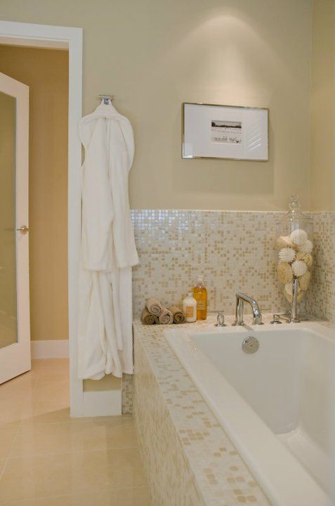 contemporary tan bathroom with drop in tub with iridescent glass tile tub surround and backsplash tan bathroom walls paint color frosted glass bathroom