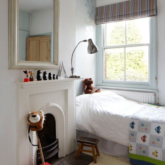 Simplicity is the key to this wonderfully charming child's bedroom. Look how that mini bed tucks so neatly into the alcove…