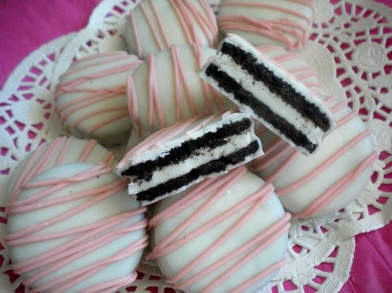 A great idea for baby showers.  Just dip double-stuffed oreo cookies in white chocolate, then drizzle icing across the top -- could do any color to match the baby shower theme.