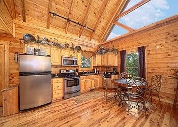 Rustic Elegance • Amazing Views Cabin Rentals - 1 Bedroom - This cabin has beautiful decor and perfect for a small family. It sleeps 6 and has a hot tub rocking chairs on the deck with a nice wooded view.