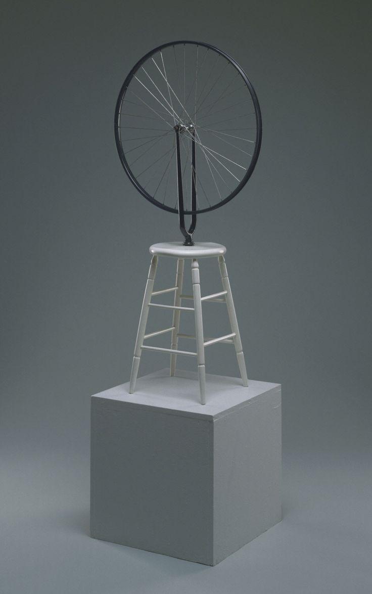 Bicycle Wheel Marcel Duchamp 1964 (replica of 1913 original) Medium: Wheel, painted wood Dimensions: Diameter: 25 1/2inches (64.8cm) Base height: 23 1/2 inches (59.7 cm)