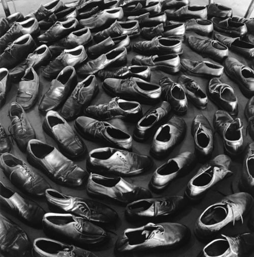 Jannis Kounellis, Shoe installation from exhibition in Jaffa Port Israel, 2007.