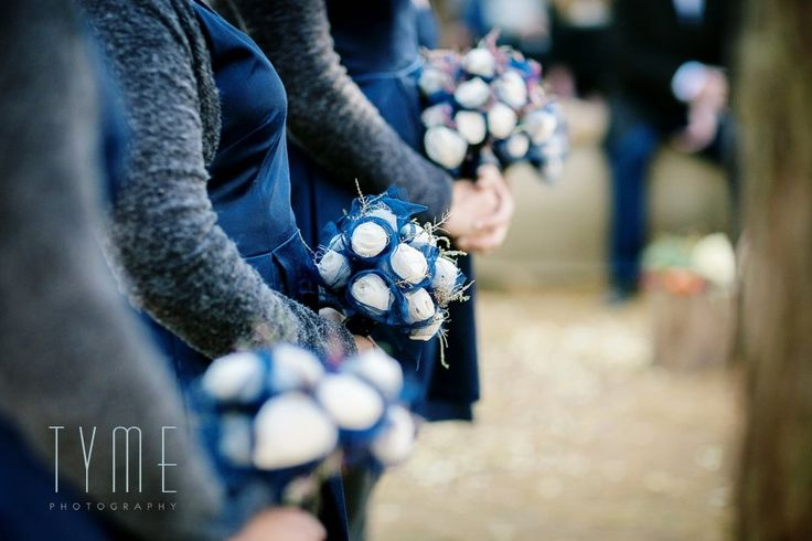 Jenni Button bridesmaids dresses in navy, grey boiled wool boleros from Sies! Isabelle and hand made white rose and blue taffeta posies.  Tyme Photography