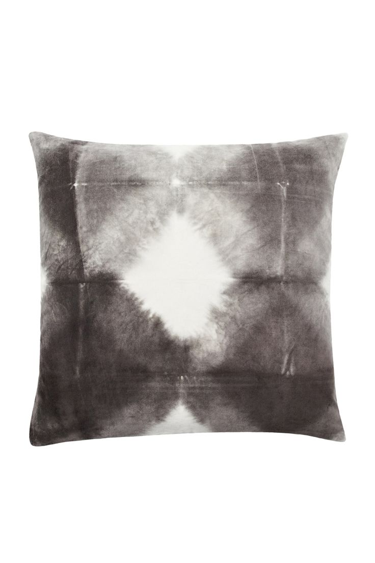 <ul> <li> Square velvet cushion</li> <li> Tie dye pattern</li> <li> Natural feather filling</li> <li> Removable cover with side zip</li> <li> Please note: this piece was individually hand dyed using a special process, making each piece original and one of a kind. No two pieces are exactly alike. Any variation in shading or bleeding is the natural result of the dyeing process and is not a defect</li> </ul>