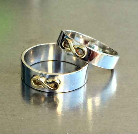 Set of wedding rings made of sterling silver band and 14 karat yellow gold infinity on the top in front. A rings that will always be classic yet unique