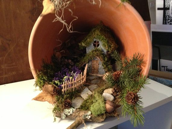 Terra cotta pot is the perfect setting for a tiny fairy house, complete with walkway, fence, and tiny garden - this is adorable! Item is for sale available on Etsy by Abizarrebazaar