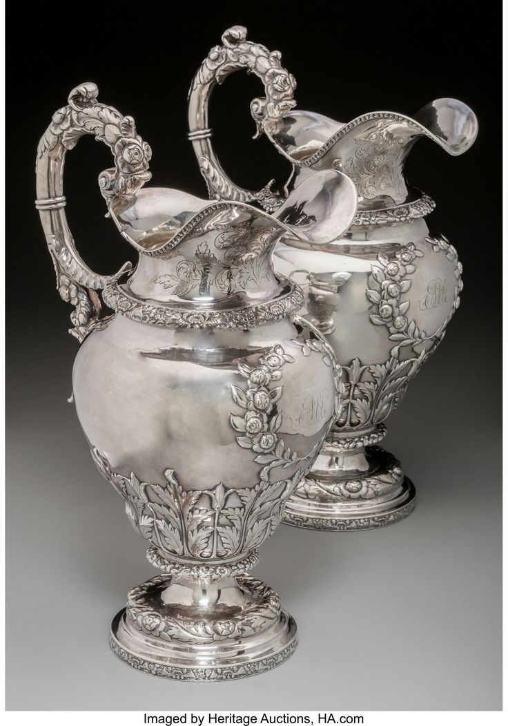 A Pair of Large Frederick Marquand Southern Coin Silver Water Pitchers, Savannah, Georgia, circa 1825 Marks: (lion passant-bust-F), FM 14-5/8 inches high (37.1 cm) 80.02 troy ounces.