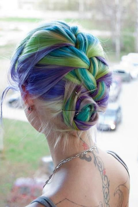 Purple, green, turquoise, lavender hair in a French braid up do.  Colorful hair. Edgy hair.