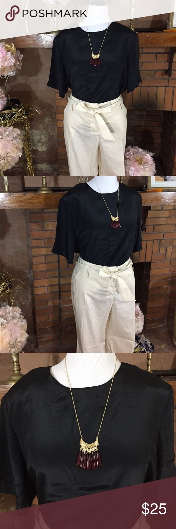 Canyon River Blues pants and black shirt Canyon River Blues cotton light tan pants sz 18. New with tags. Black shiny shirt with shoulder pads. 100% Polyester. Sz 20. Previously owned. Gold tone necklace with red beads new with tags. Please check out all pictures for best description of the items.  Ask me any questions and happy shopping! Canyon River Blues  Pants Trousers
