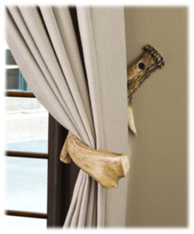 Finally an idea of what to do with all of the horns not big enough to mount..Antler Curtain Hooks