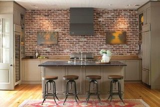 Reclaimed Thin Brick Veneer adds instant character to this eating area.
