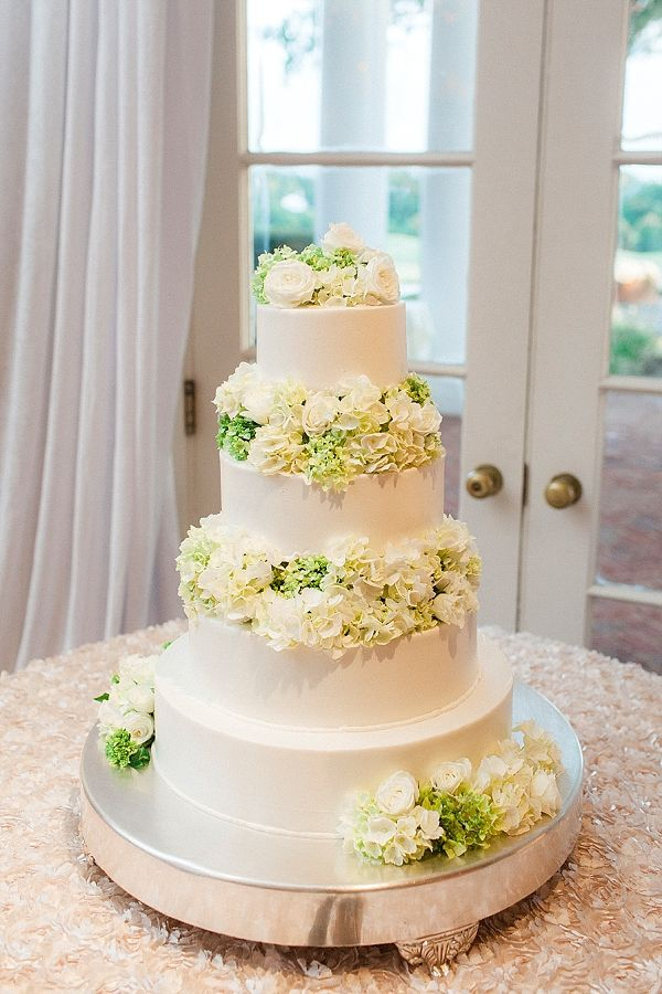 Classic tiered wedding cake with lots of flowers