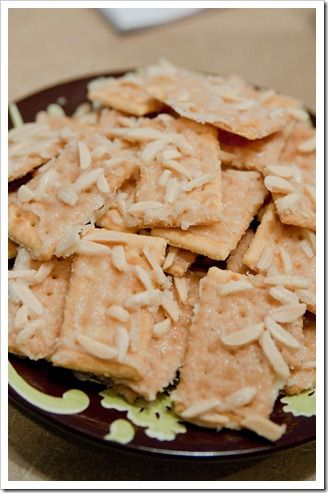NUTTY CRACKER DELIGHTS    Appx. 42 Club Crackers    I stick {1/2 cup} butter    1/2 cup sugar    1 tsp. vanilla    1 cup slivered almonds