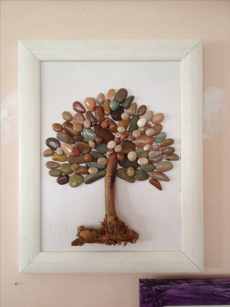 Tree with driftwood and polished rocks