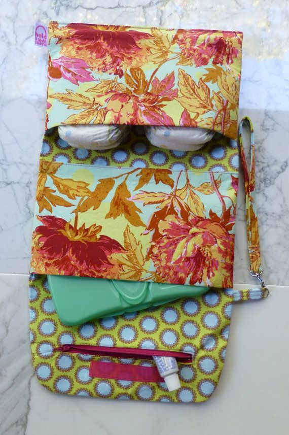 Tri-Fold Diaper Clutch Bag holds all baby's essentials