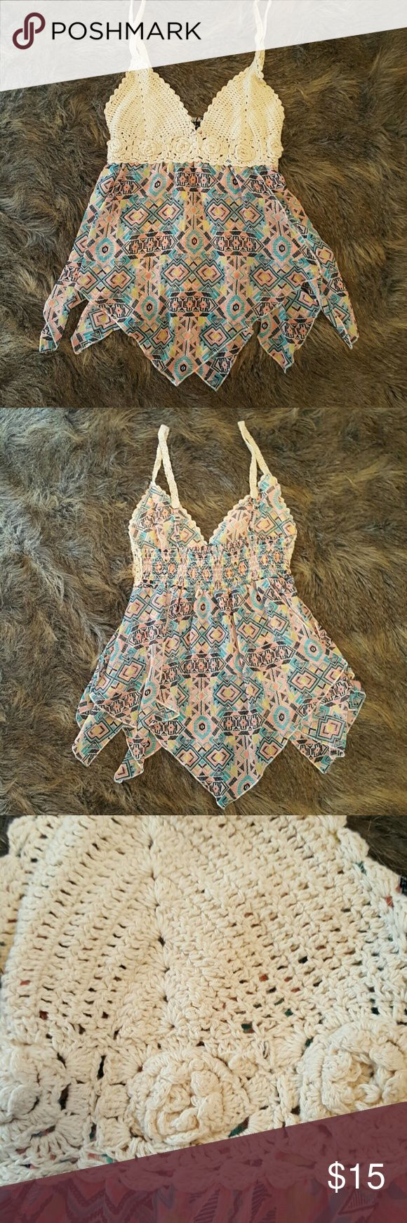 Tribal print and crochet top Tribal print and crochet top. Asymmetric bottm. Stretch back. Light and flowing. Approx length from top of shoulder to bottom 23-25 inches. Could fit small or medium Rue 21 Tops