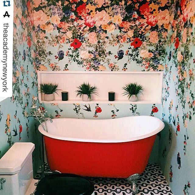 "charming bathroom lined with Christian Lacroix Maison ""Vuelta"" fabric."