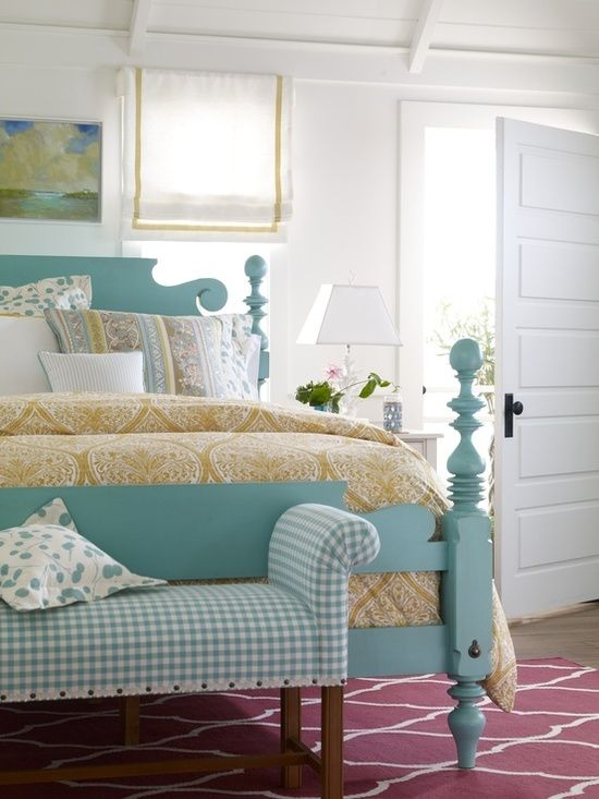 Love the bed, color of the bed, and the quilt - interiors-designed.com... and the white 5-panel door with black knob.