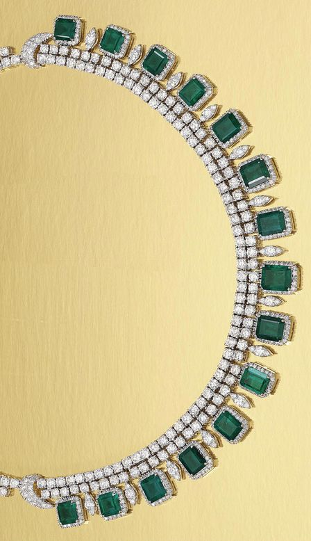 EMERALD AND DIAMOND NECKLACE Designed as two articulated lines of brilliant-cut diamonds, suspending to the front a gently graduated fringe of emeralds within borders of brilliant-cut diamonds, to a diamond set back, length approximately 415mm.