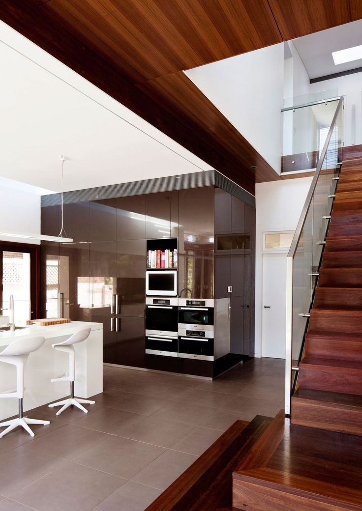 Kitchen and stairs Mosman House Australian Residence Engaging with the Backyard by Anderson Architecture