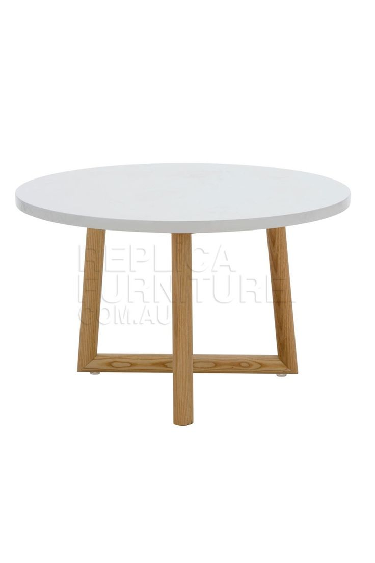 Danish Side Table White -- This classic Danish style side table is crafted from ash wood and finished with a gloss white table top. The solid wood legs create the true retro Danish style, and this petite side table oozes mid-20th century charm and sophistication.  Perfect for use between armchairs, this wooden side table has a diameter of 60 cm so is large enough for coffee and treats.  Also suitable as a smaller size coffee table, this round wooden table is cute and stylish.--249.0000