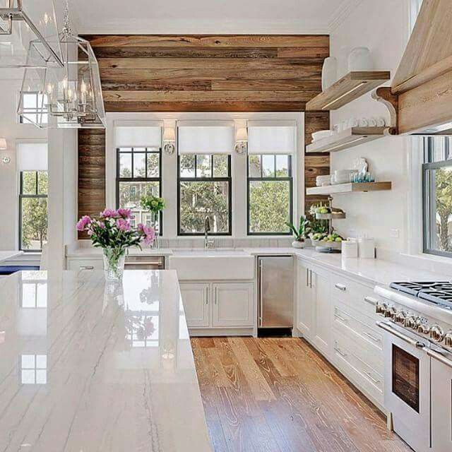 Open Shelving! Accent wall of natural wood looks amazing with the all white kitchen!